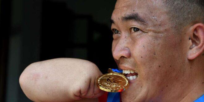 صينى بدون ساعدين يسعى وراء حلمه فى رياضة التايكوندو بعد احترافه بعام واحد